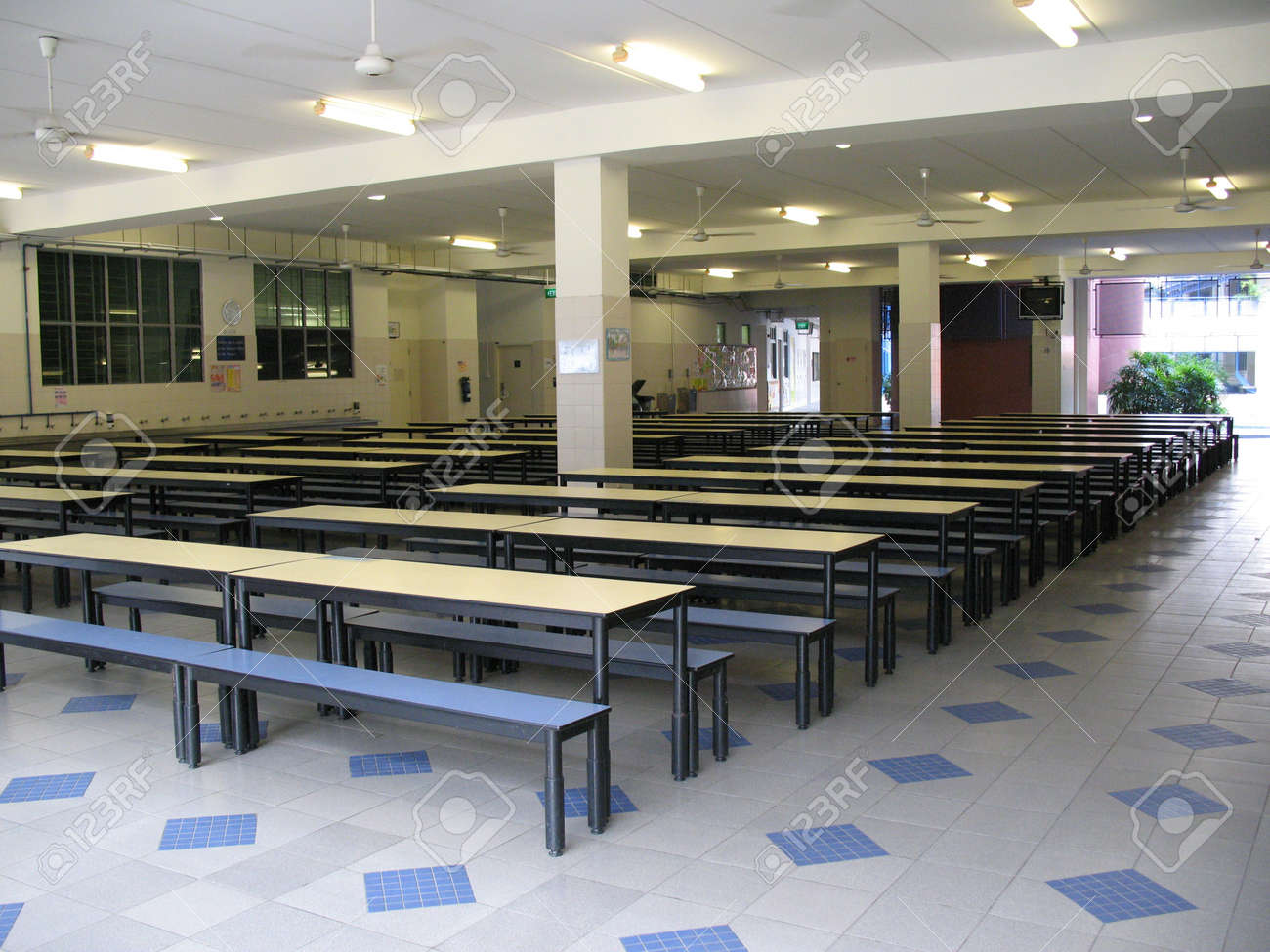 Empty School Canteen With Lots Chairs And Tables Stock