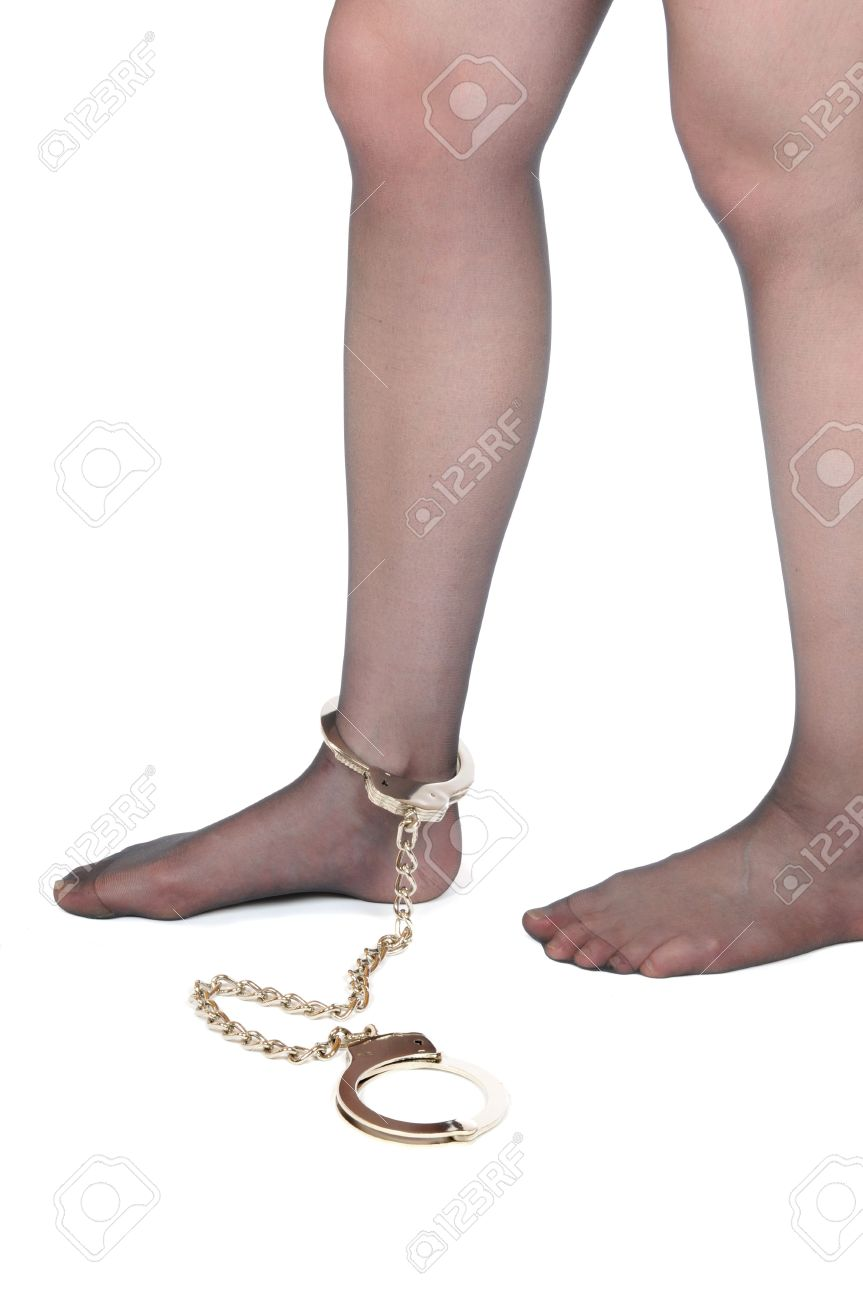 Legs of a young woman in shakles Stock Photo - 4821630
