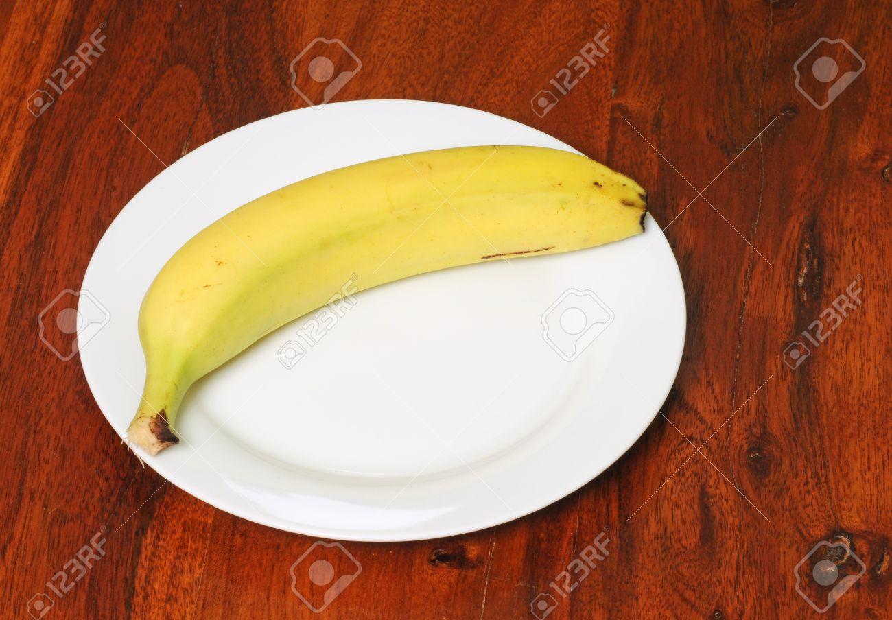 Banana On Table Banana on a table made of maple Stock Photo - 12471322