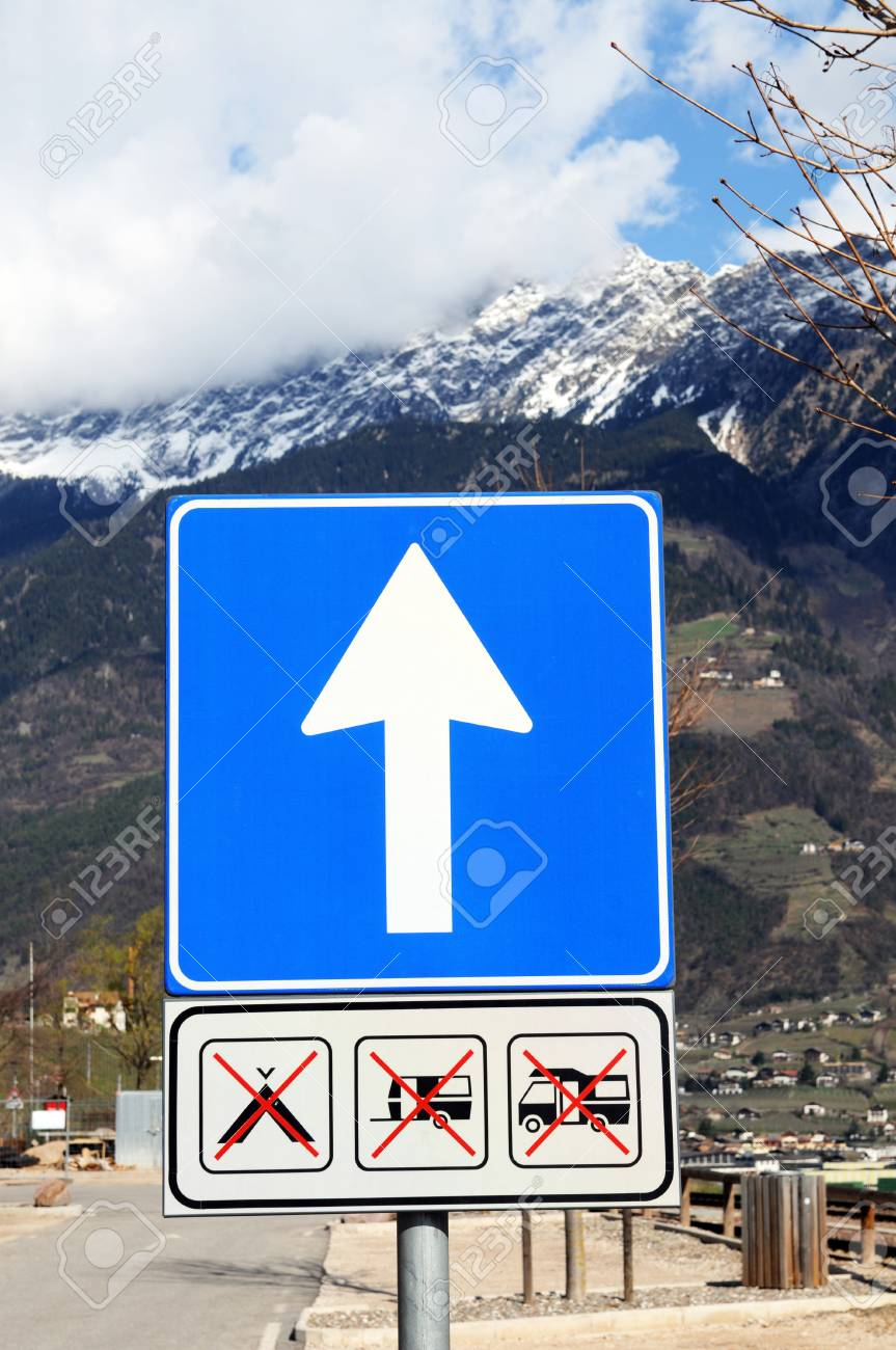 Blue arrow sign in the alps Stock Photo - 12942608