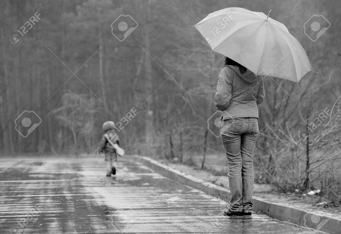 Mother wathces as her son goes away in a stormy weather Stock Photo - 6788767