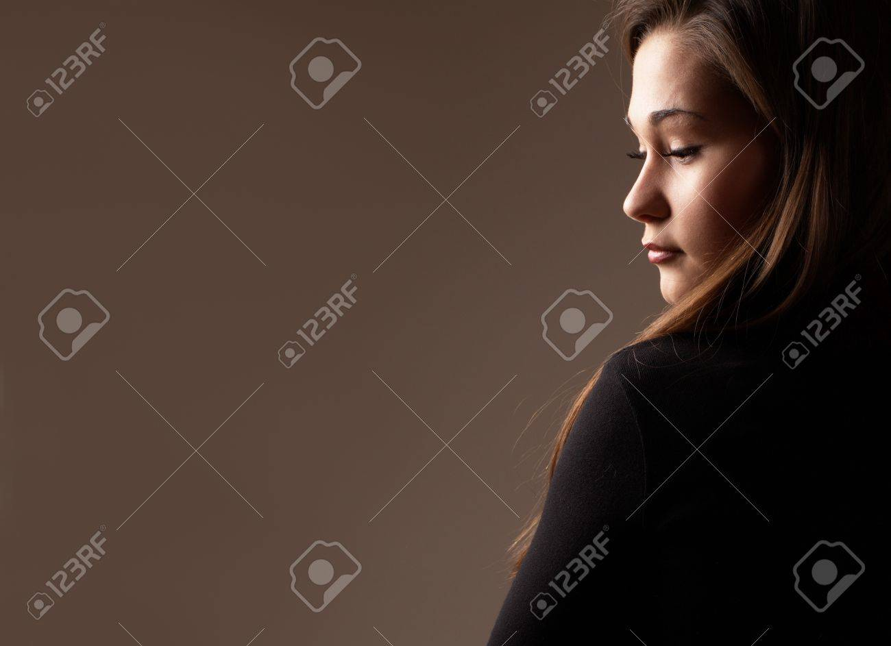 Backlit portrait of an asian woman profile in low key Stock Photo - 8296426
