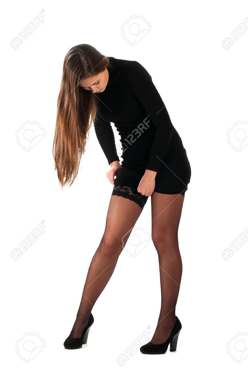 Woman in tight black dress tighten her stockings isolated on white Stock Photo - 9402641