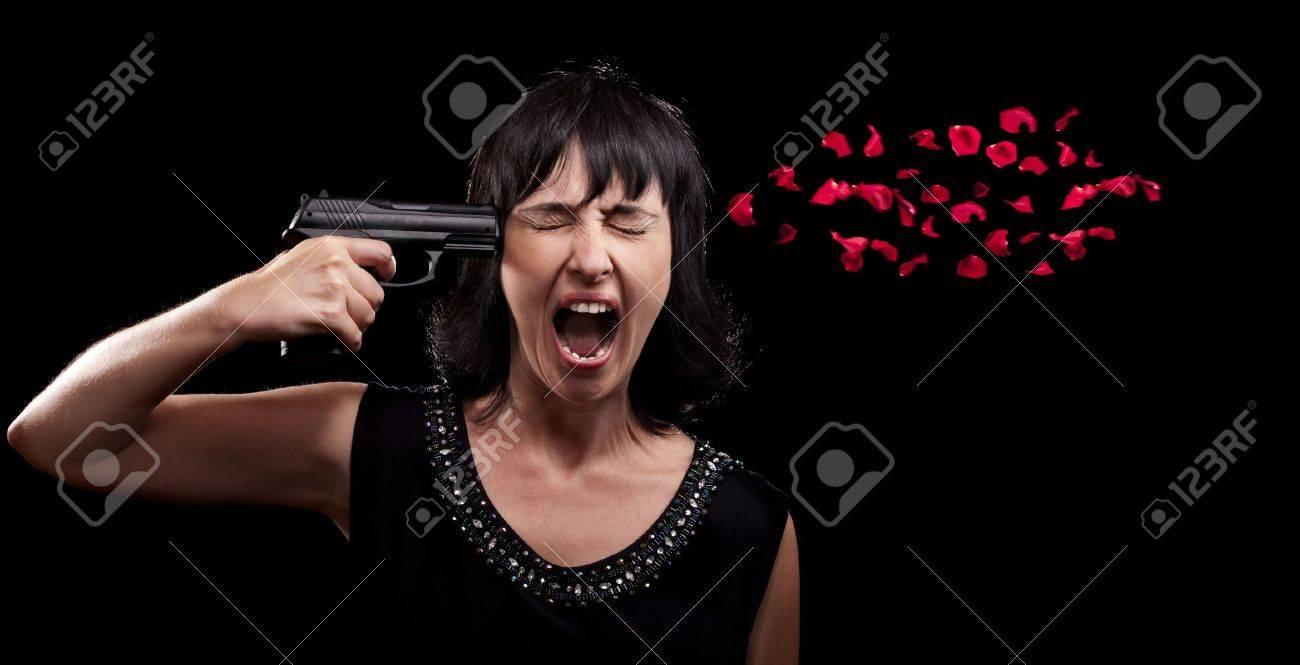Screaming woman suicide gun shot over black Stock Photo - 9959383