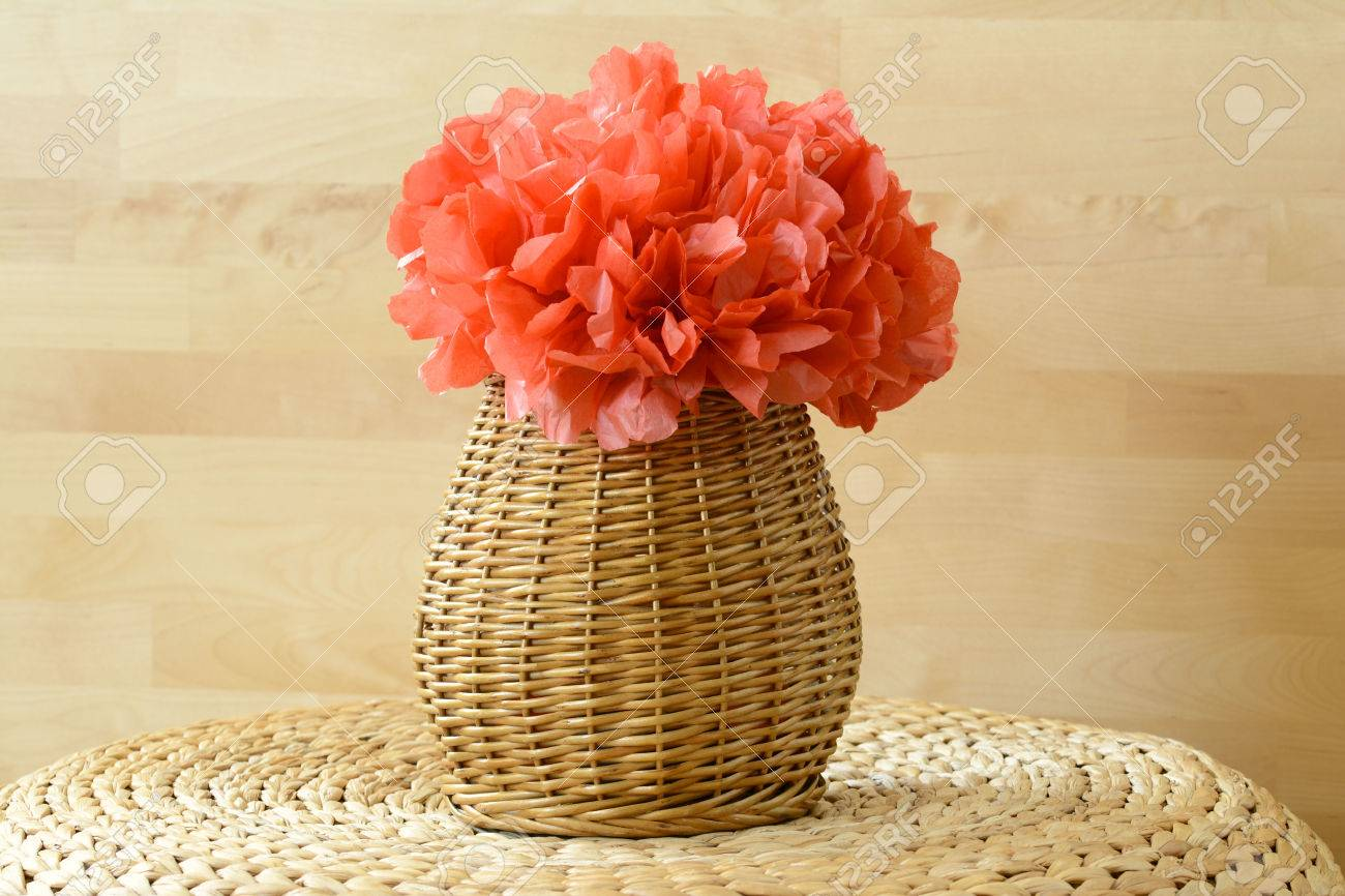 Woven Vase Basket With Red Tissue Paper Flower Pom Pom Stock Photo