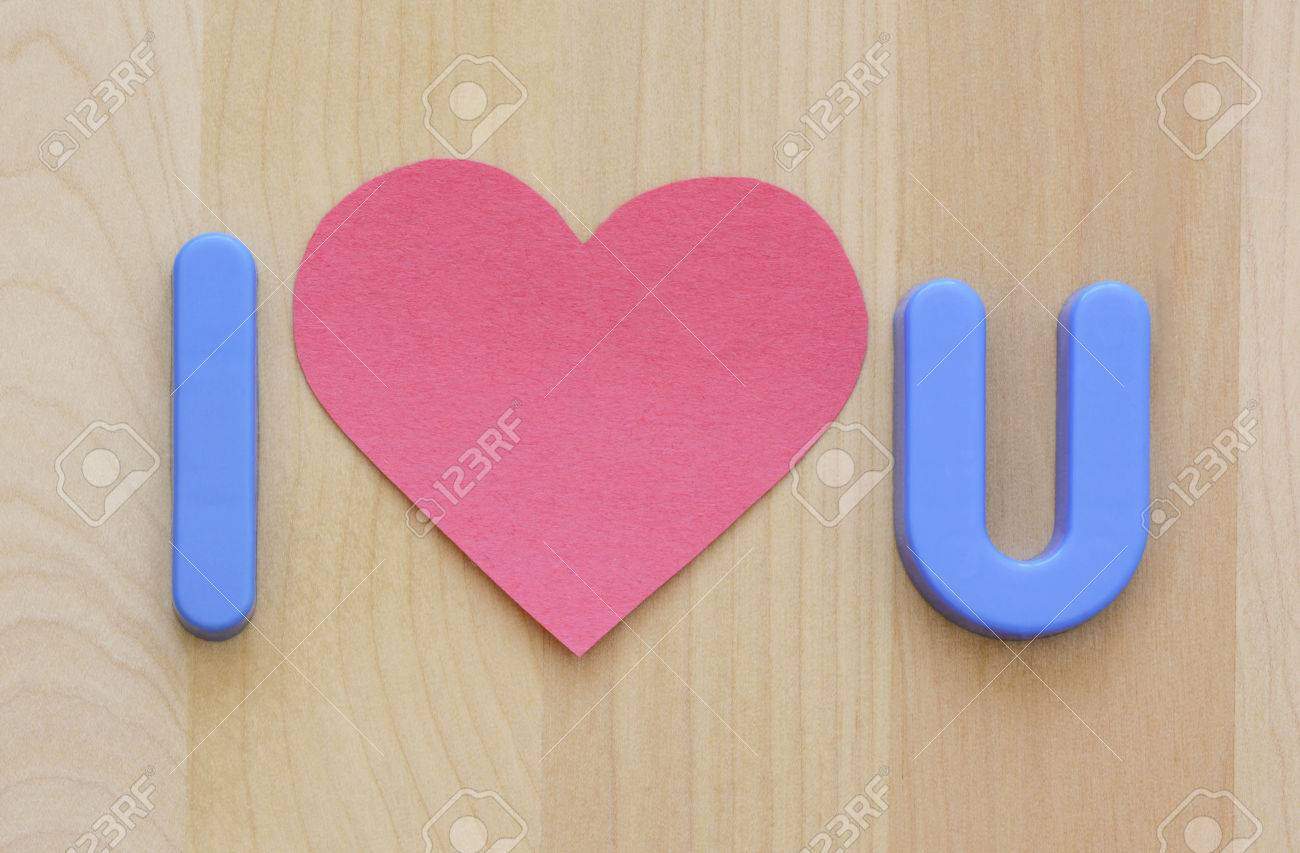Close Up Of I Love U In Blue Plastic Toy Letters And Flat Pink