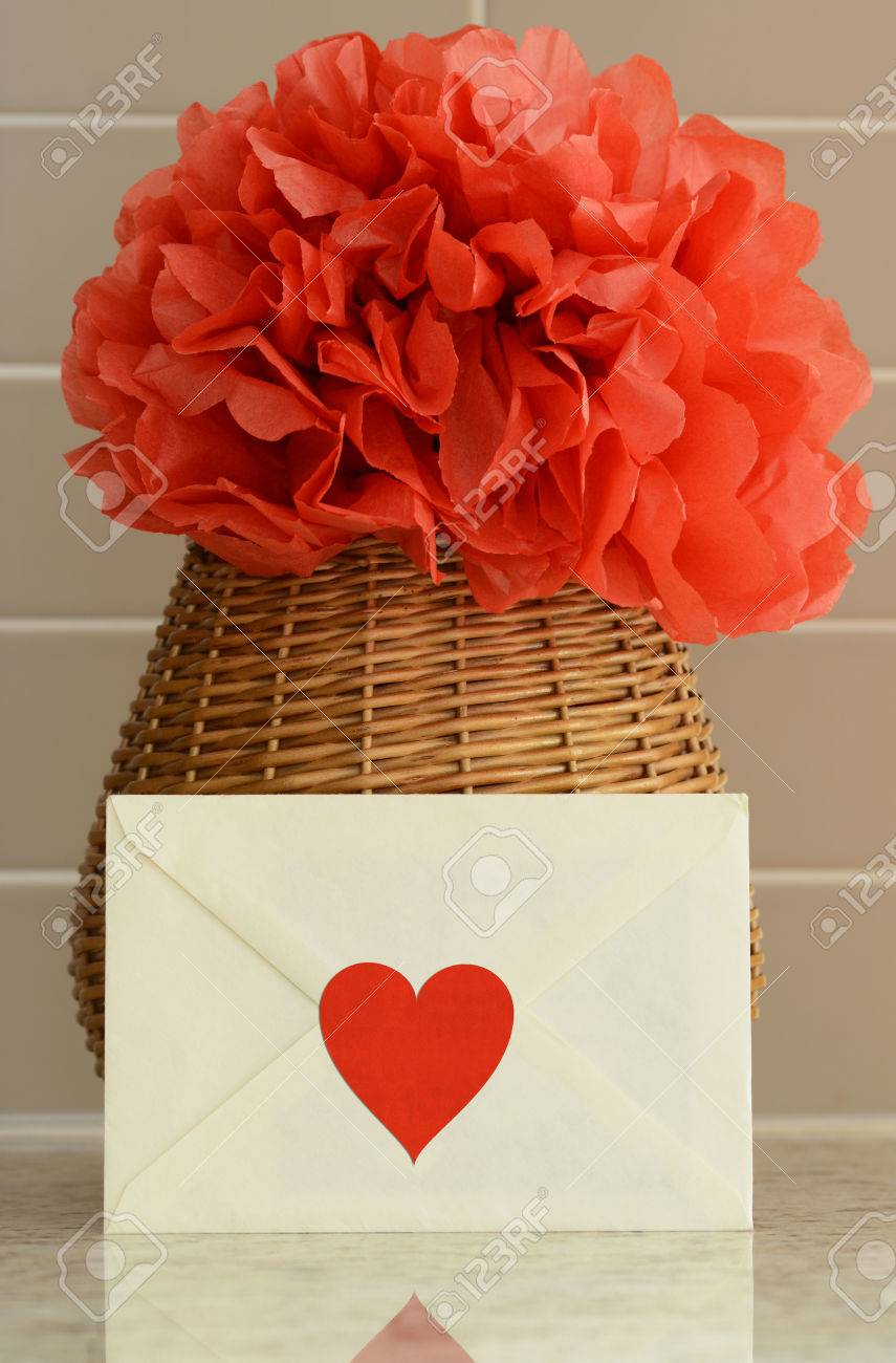 Vase basket with red tissue paper flower and love letter stock photo stock photo vase basket with red tissue paper flower and love letter mightylinksfo