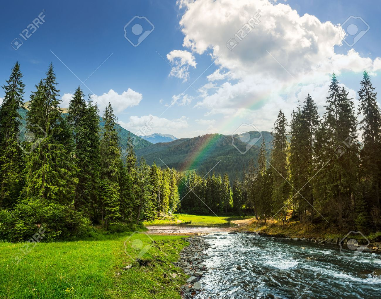 collage landscape with pine trees in mountains and a river in front flowing to lake in sunset light with rainbow - 34797853