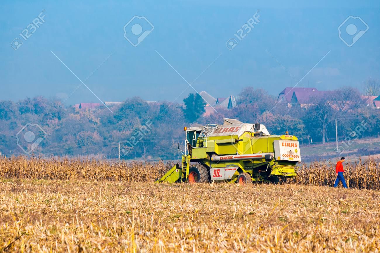 Shyroke, Ukraine - NOV 11, 2015: broken combine harvester in the corn field near the village. combine operator went searching for help. hot autumn afternoon - 107011690