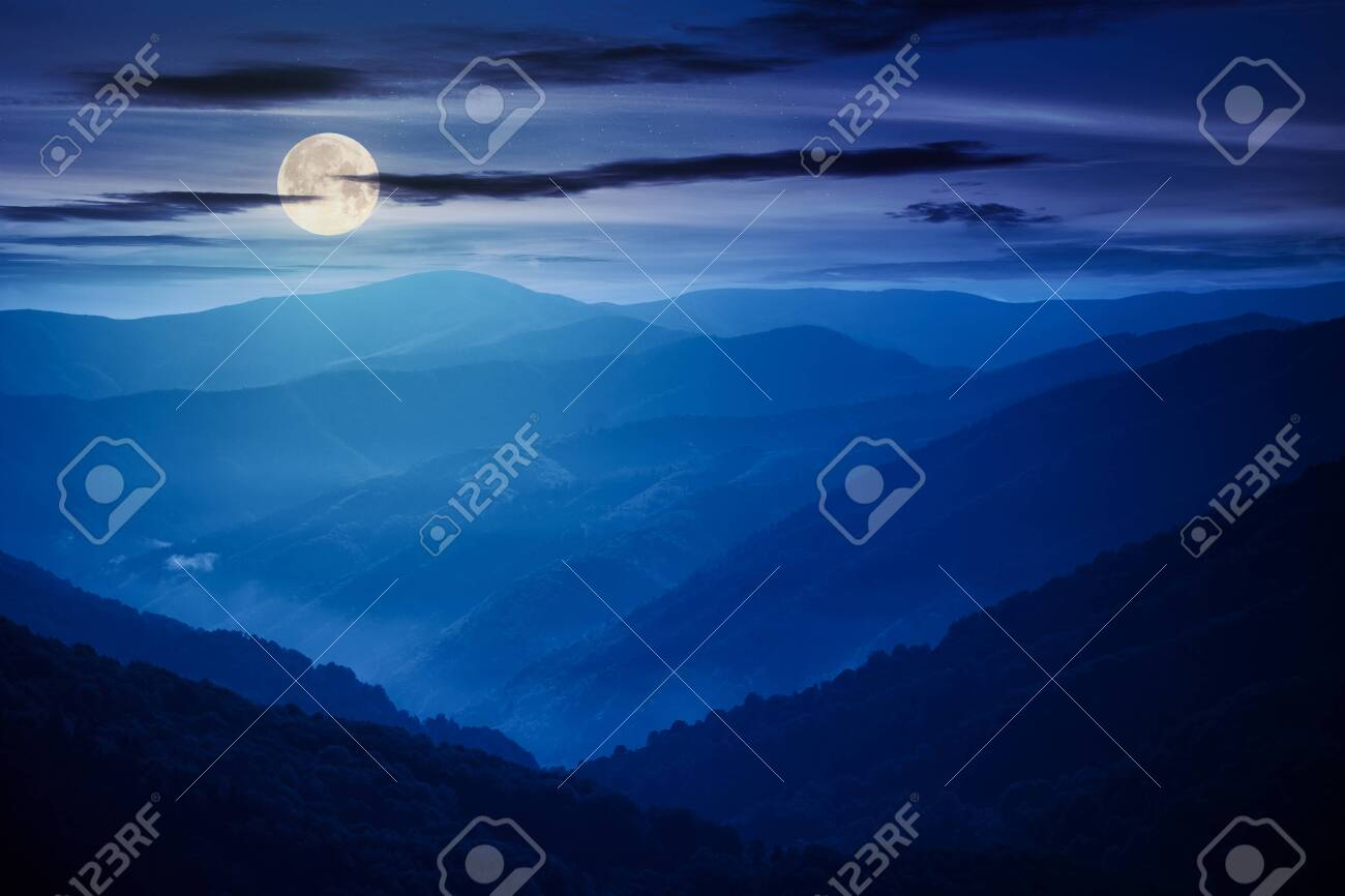mountain landscape on a summer night. hills rolling from the valley up in to the distant ridge. view of the summer scenery in full moon light - 151626391