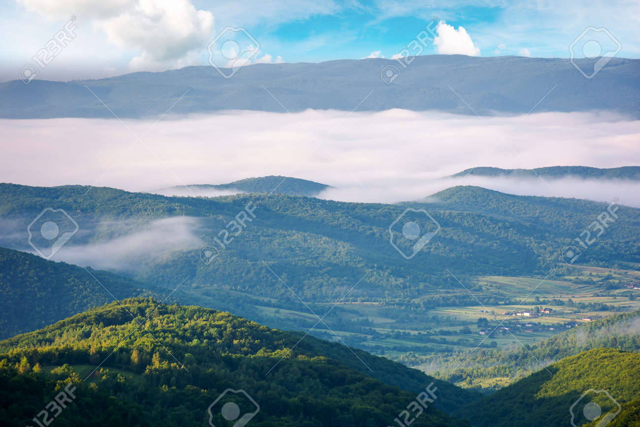 glowing fog in the rural valley at dawn. beautiful mountain landscape in springtime. view from the hill - 170870303