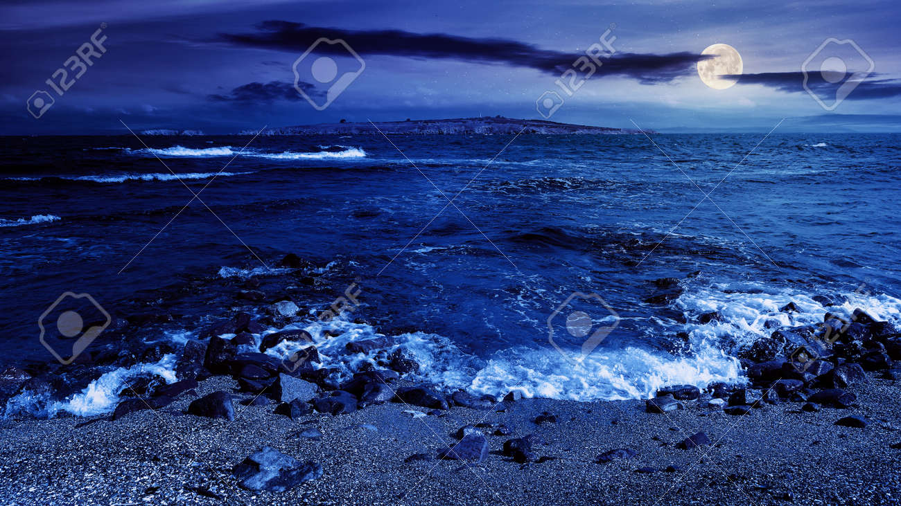seascape at night. wonderful scenery with islands in full moon light. clouds above horizon. fantasy travel destination in summer - 171751757