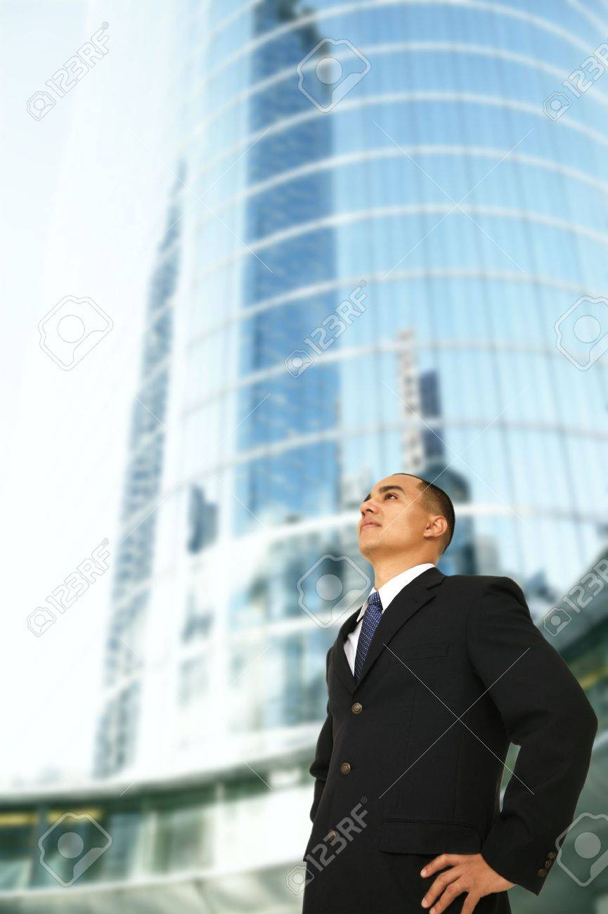 An Architect Or Designer Or Business Owner Or Ceo Of A Big Company Standing  By Tall
