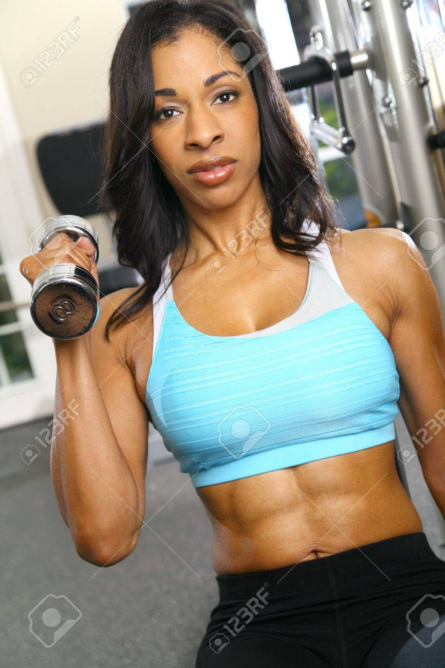 african american woman training or exercising in gym, doing weight lifting Stock Photo - 4248570