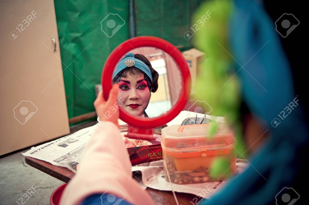 CHENGDU, CHINA-MARCH 12, 2011: Unidentified actor prepares backstage for the Sichuan opera on March 12, 2011, in Chengdu, China.  Sichuan opera is a Chinese folk tradition that originated in China around 1700. Stock Photo - 12734531
