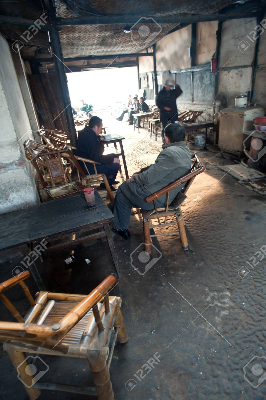 CHENGDU-JANUARY 24, 2010: The unnamed elderly in an old teahouse tea, this tea house will be removed and relocated due to urban renewal, the elderly can not come here to drink tea. January 24, 2010, Chengdu, China Stock Photo - 12768580