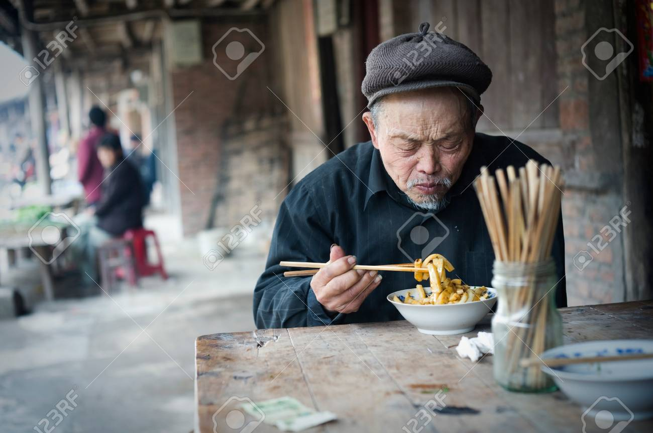 QIJIANG,SICHUAN, CHINA - APRIL 4, 2010:unnamed villagers are dining, Sichuan Province, China, April 4, 2010. Many elderly people live like this. Stock Photo - 12768496