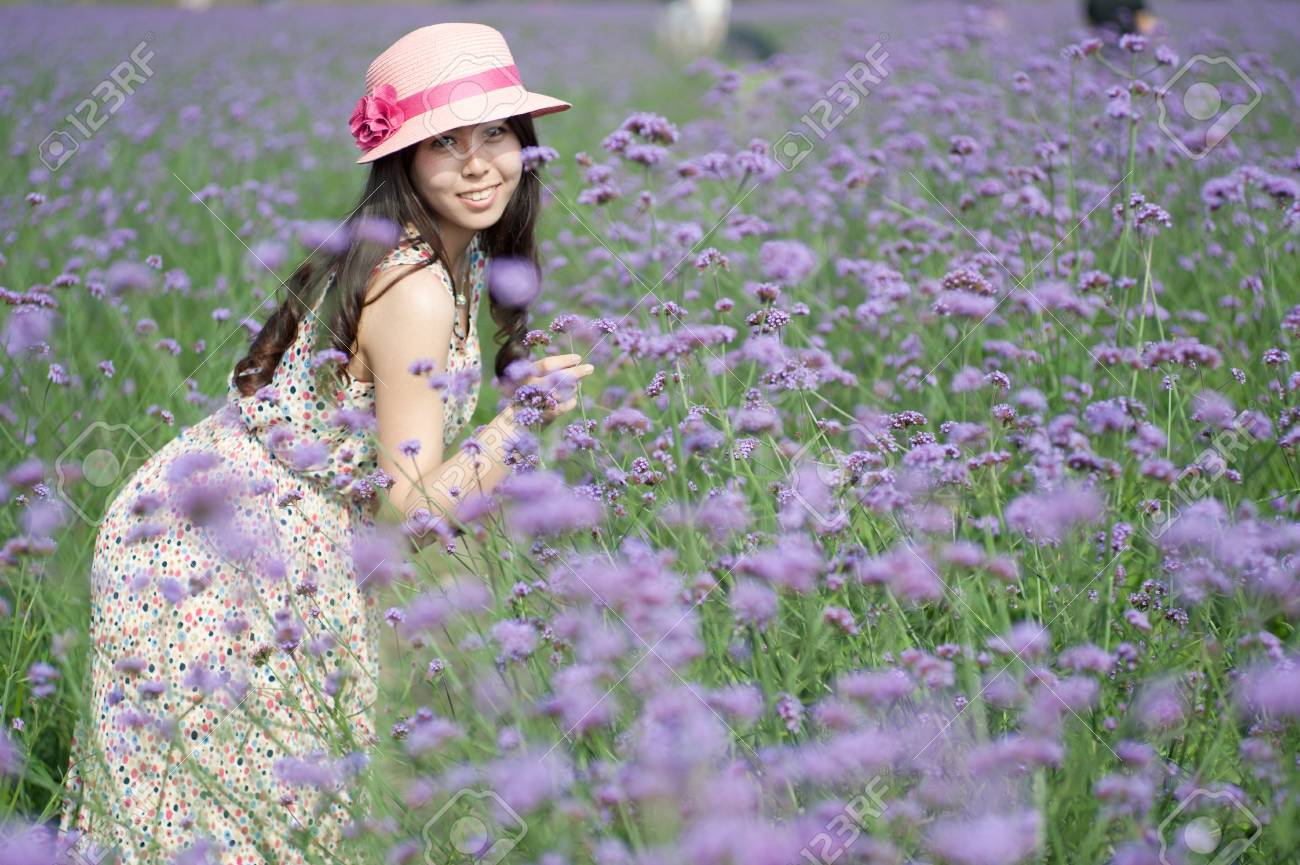 A Chinese young women playing in the vast lavender Stock Photo - 14194251