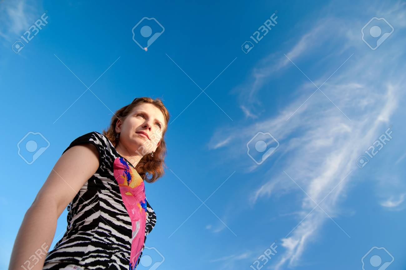 a beautiful girl on a background of blue sky Stock Photo - 8086256