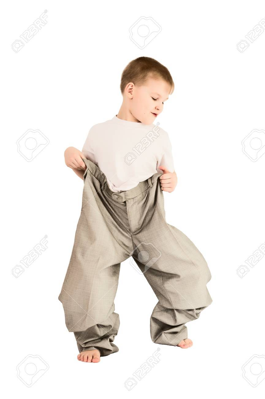 This photograph shows a boy in father's trousers Stock Photo - 10199344