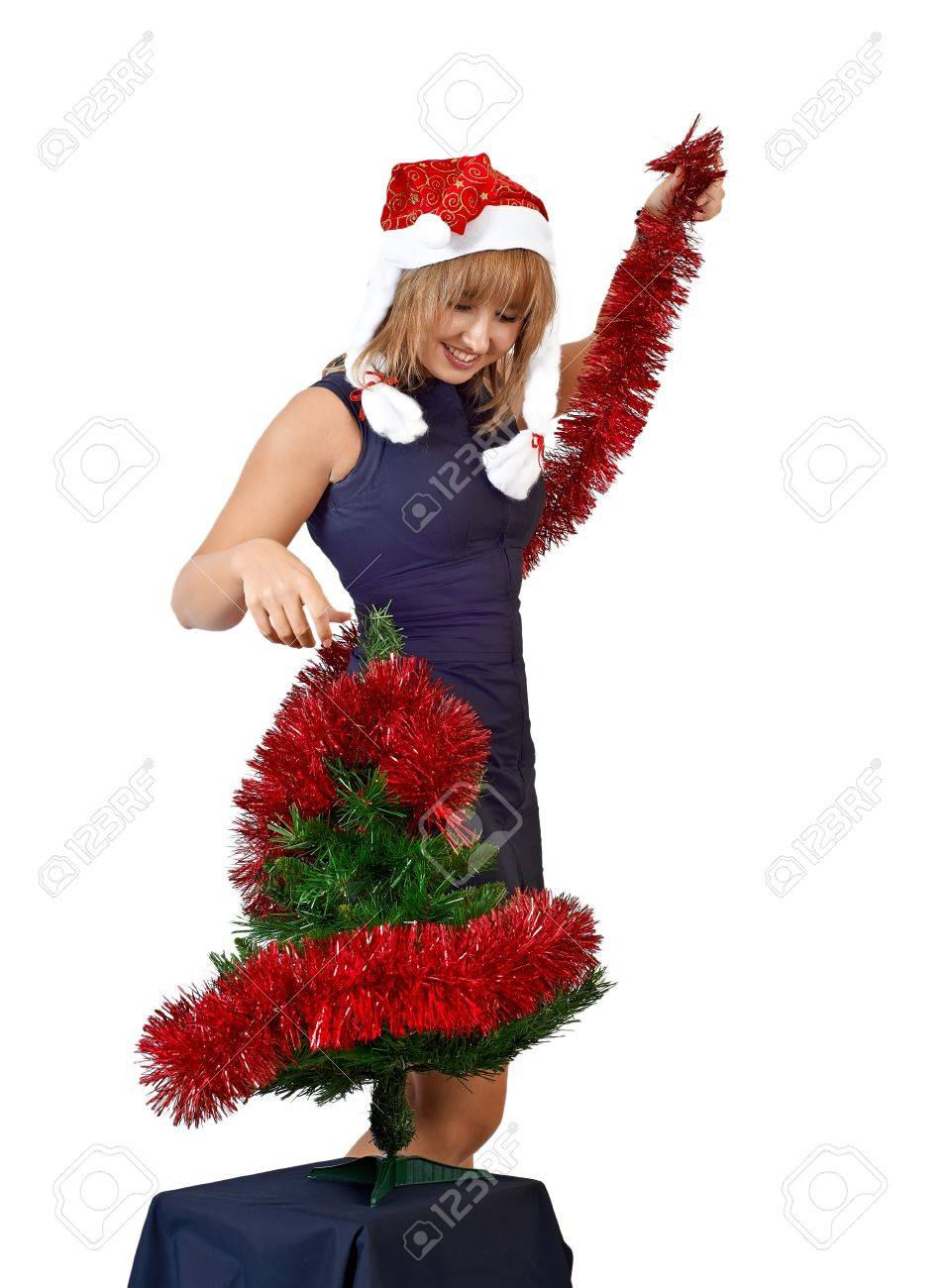Christmas tree dress up images - Stock Photo Beautiful Girl In The Hat Of Santa Claus Dress Up The Christmas Tree