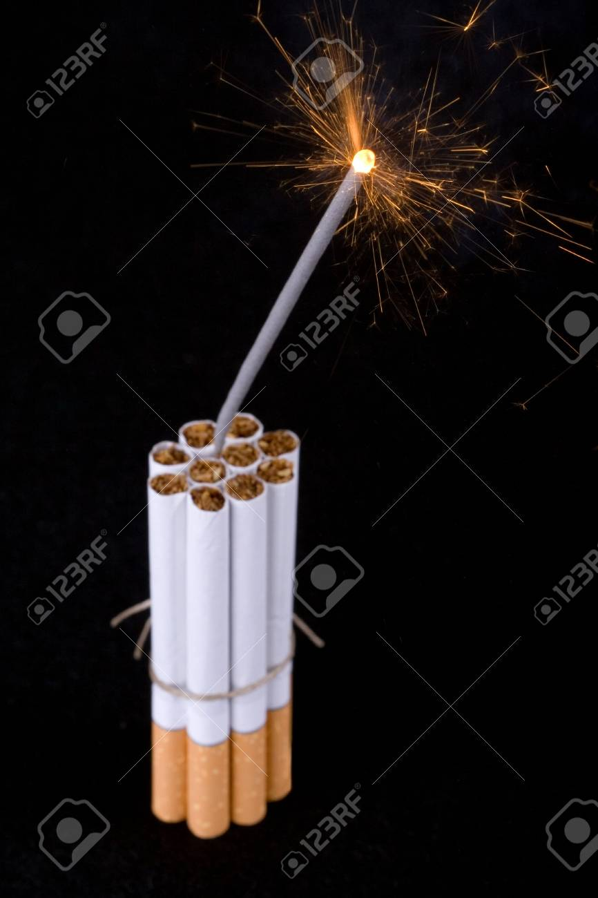 Bomb made of cigarettes with long burning fuse Stock Photo - 913551