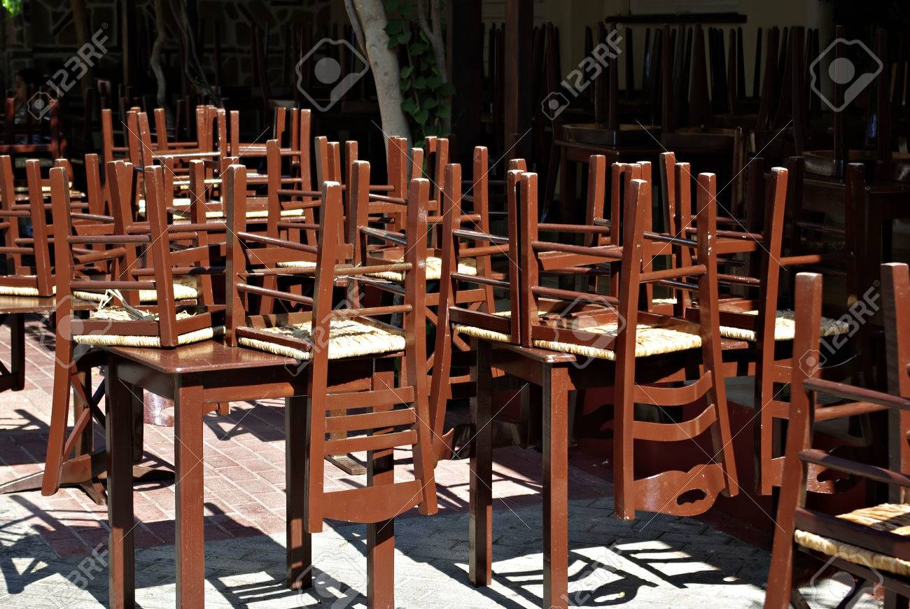 Closed Restaurant With Old Fashioned Brown Wooden Chairs Set Stock - Restaurant table and chair sets