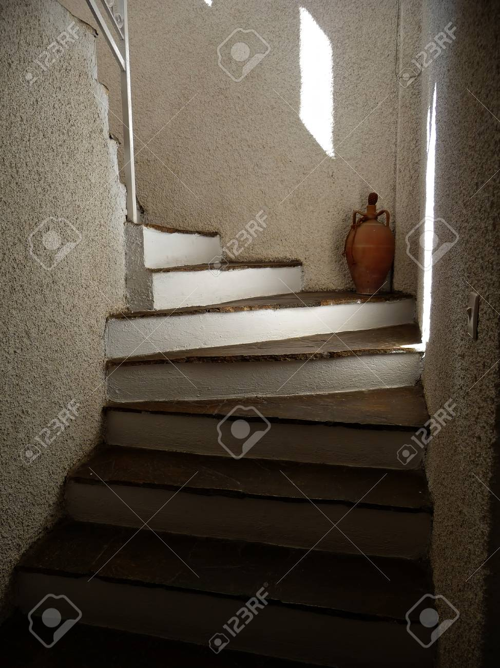 Interior Decoration White Stairs Clock On The Wall Vase In