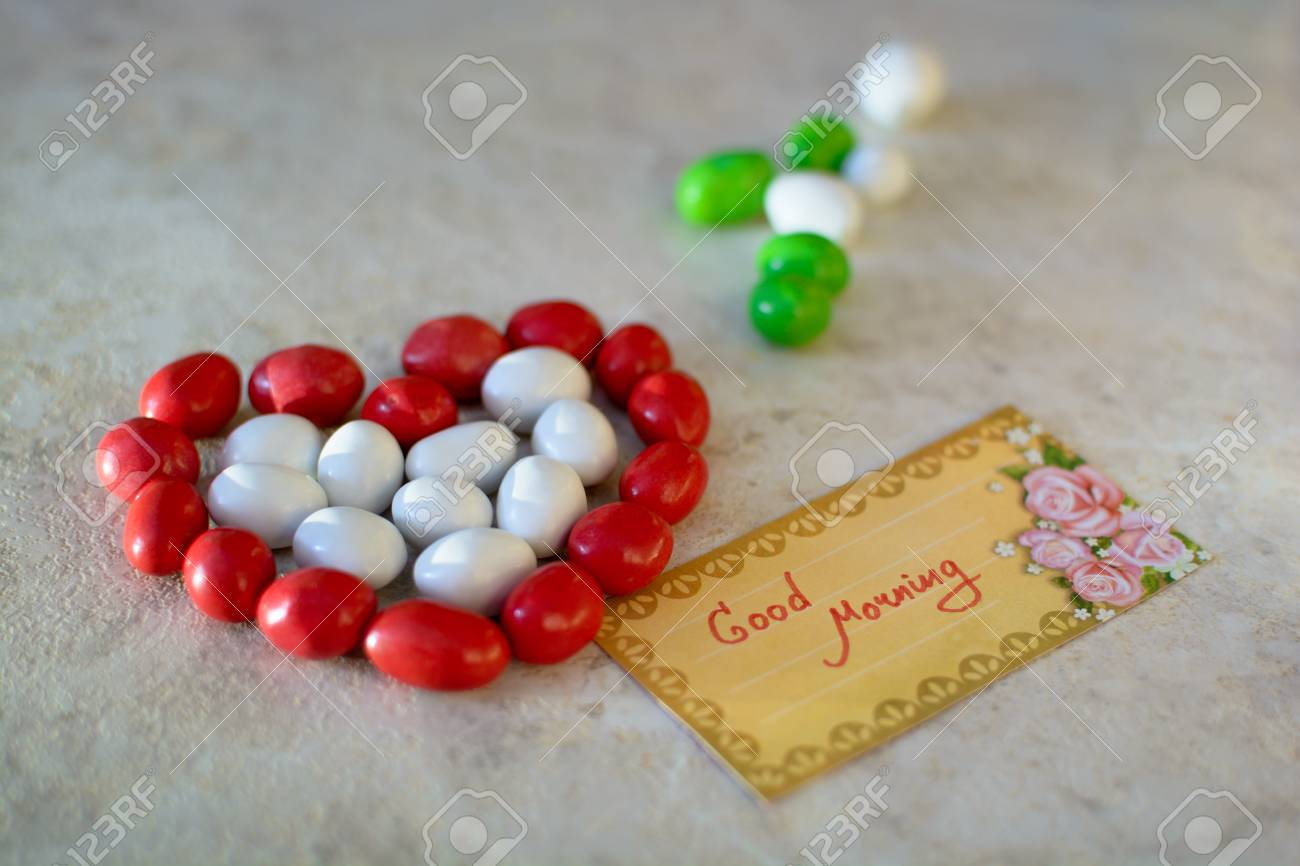 Heart made of candies with good morning message