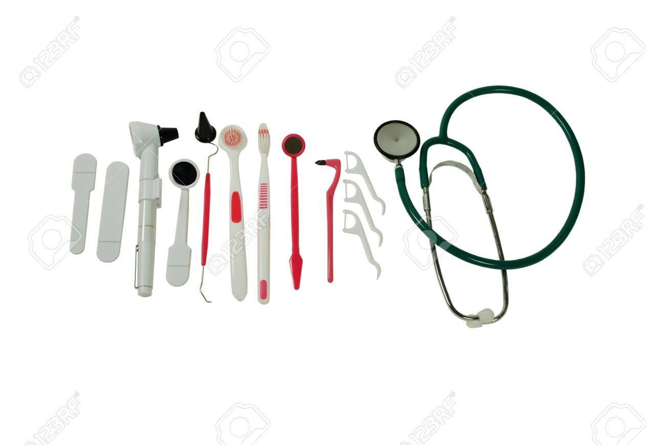 Un conjunto de instrumentos dentales para la higiene personal, un alcance y stethoscoope Foto de archivo - 3953669