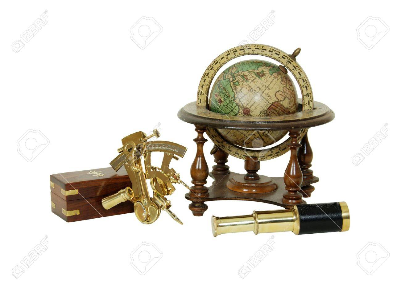 Brass Sextant used for navigating by the stars, telescoping telescope used to see distances, Old world globe with basic navigation notations Stock Photo - 3954371