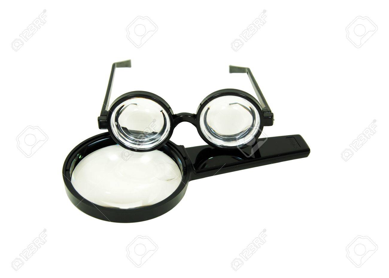 Thick lenses on black frames often worn by nerds and magnifying thick lenses on black frames often worn by nerds and magnifying glass used to get a jeuxipadfo Images