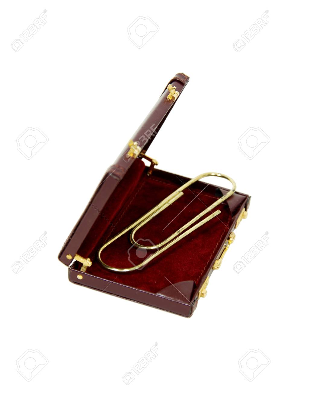 Paperclip used to hold pages or other media together in a leather briefcase used to carry items to the office Stock Photo - 4179143