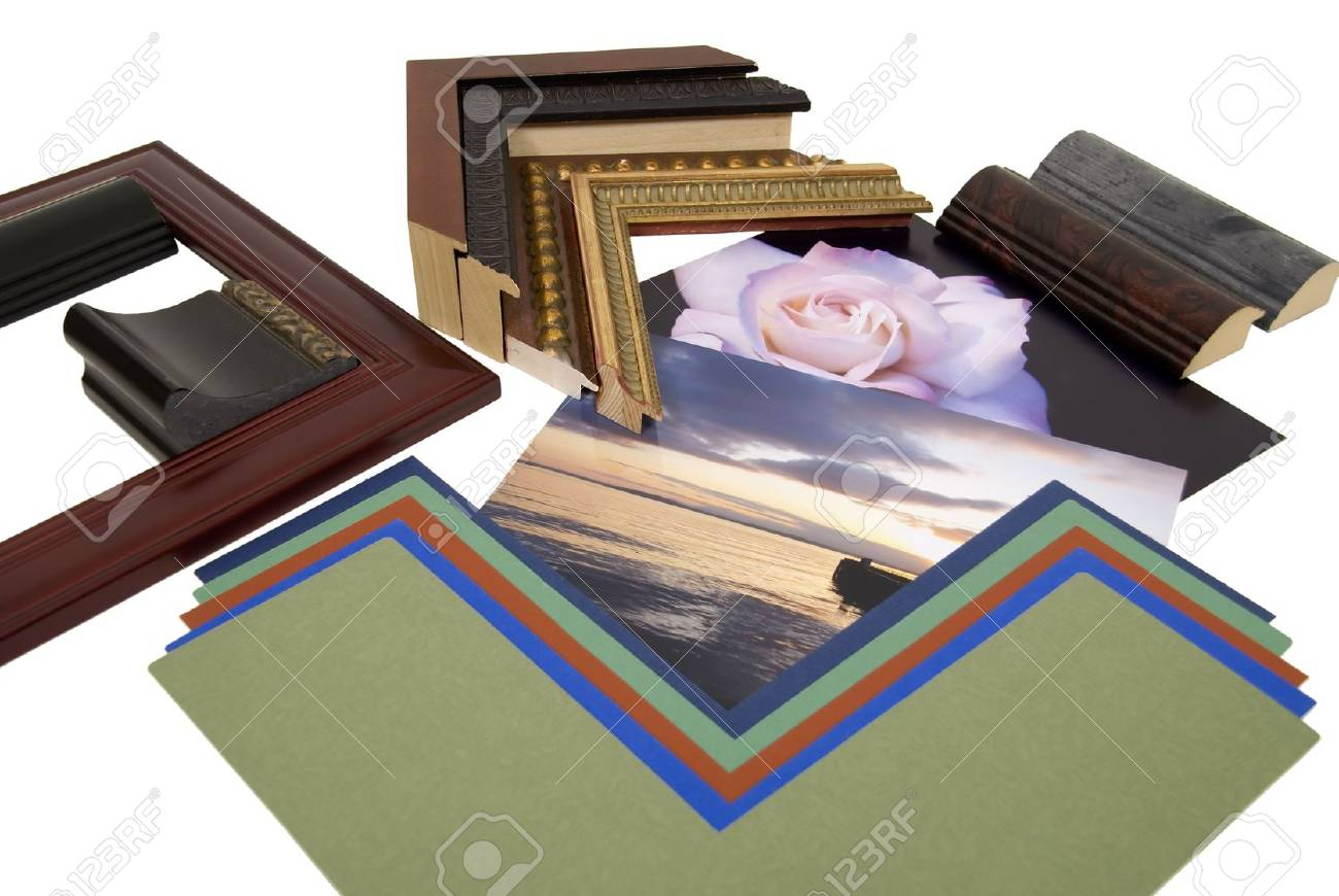 Deciding on a framing project with an assortment of colored matboard and frame samples - path included - 4834454