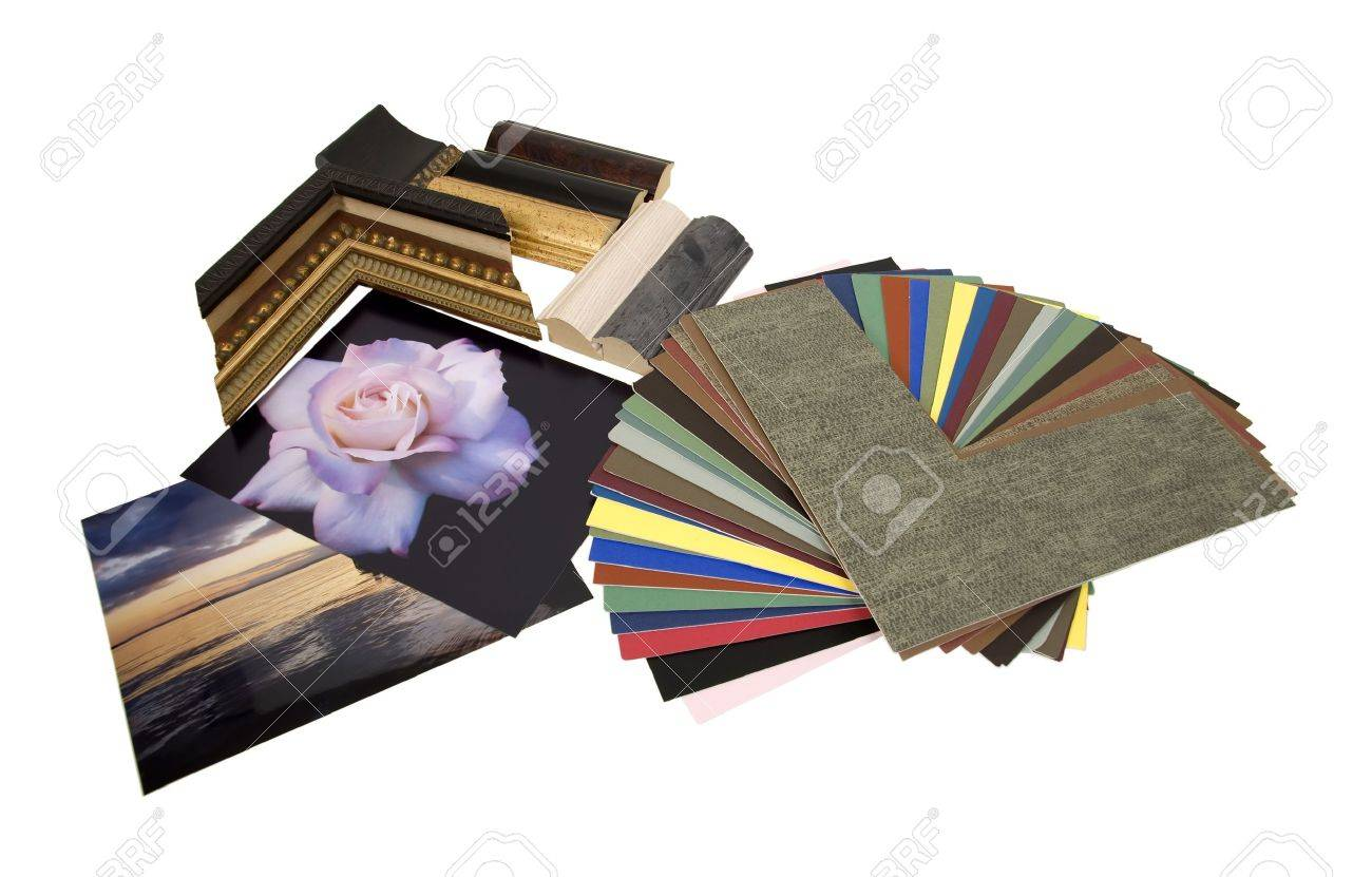 Deciding on a framing project with an assortment of colored matboard and frame samples - path included - 4834410
