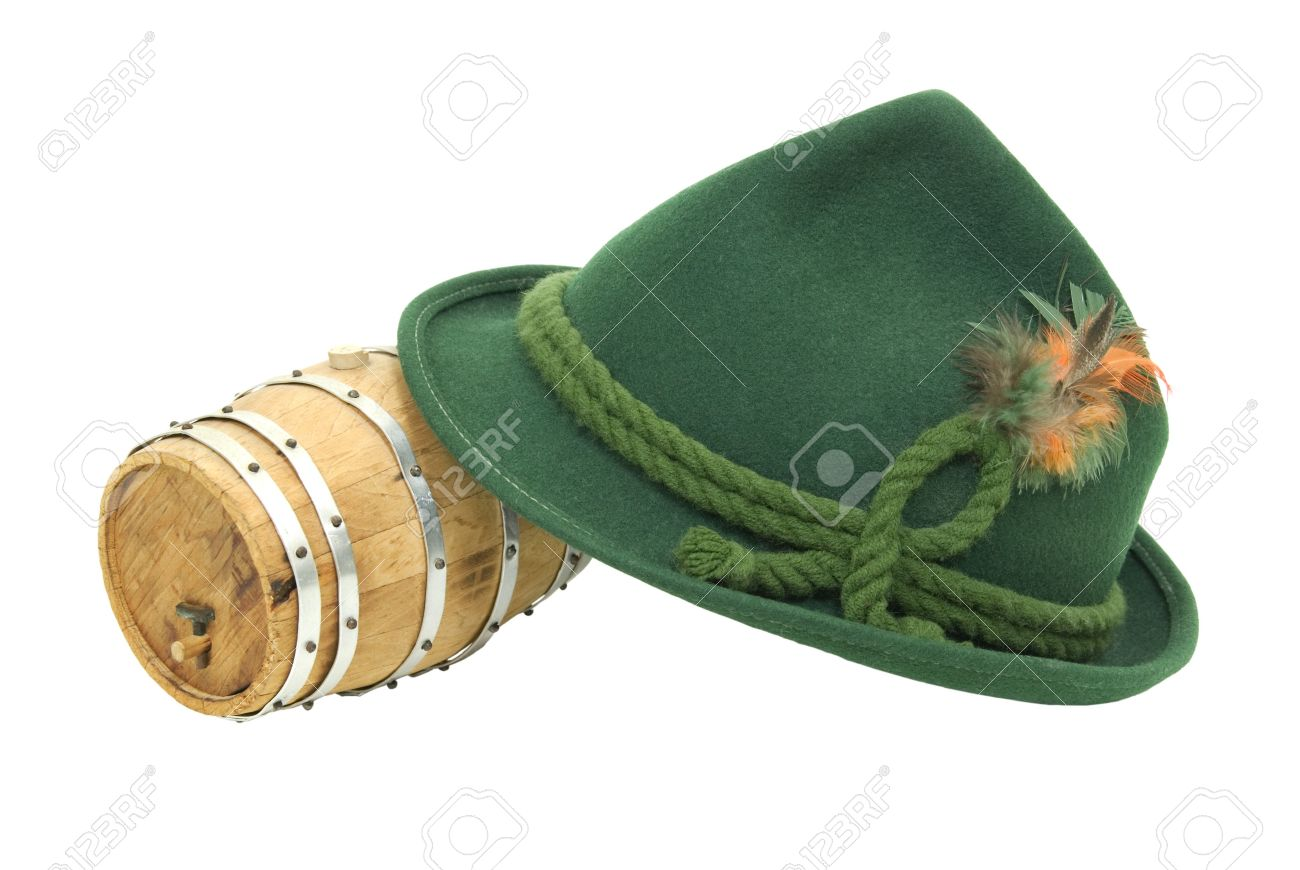 55cdc150bdc Stock Photo - Traditional green felt German alpine hat with rope twists and  bright feathers with an oak barrel