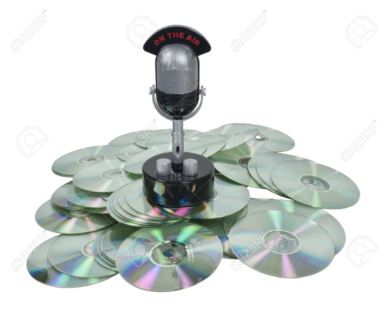 Saved broadcasts shown by a retro pill audio microphone on a pile of disks Stock Photo - 9445682