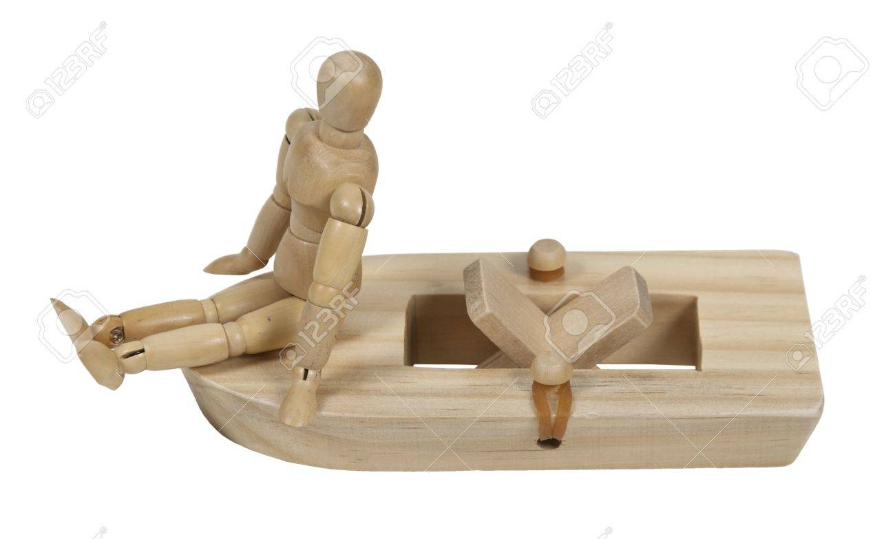 Relaxing On A Rubberband Powered Wooden Paddle Boat Stock Photo