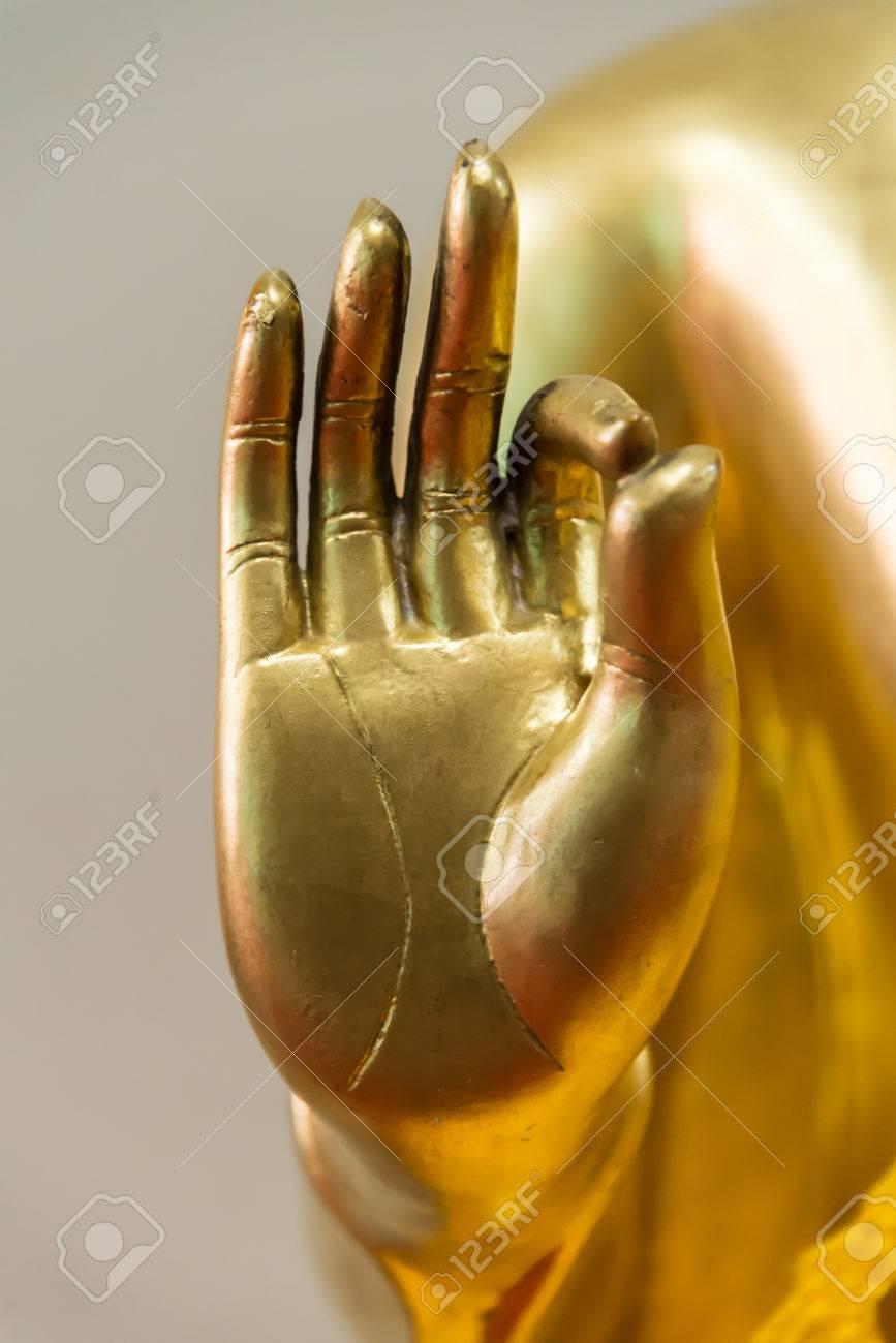 Buddha peace sign hand closeup