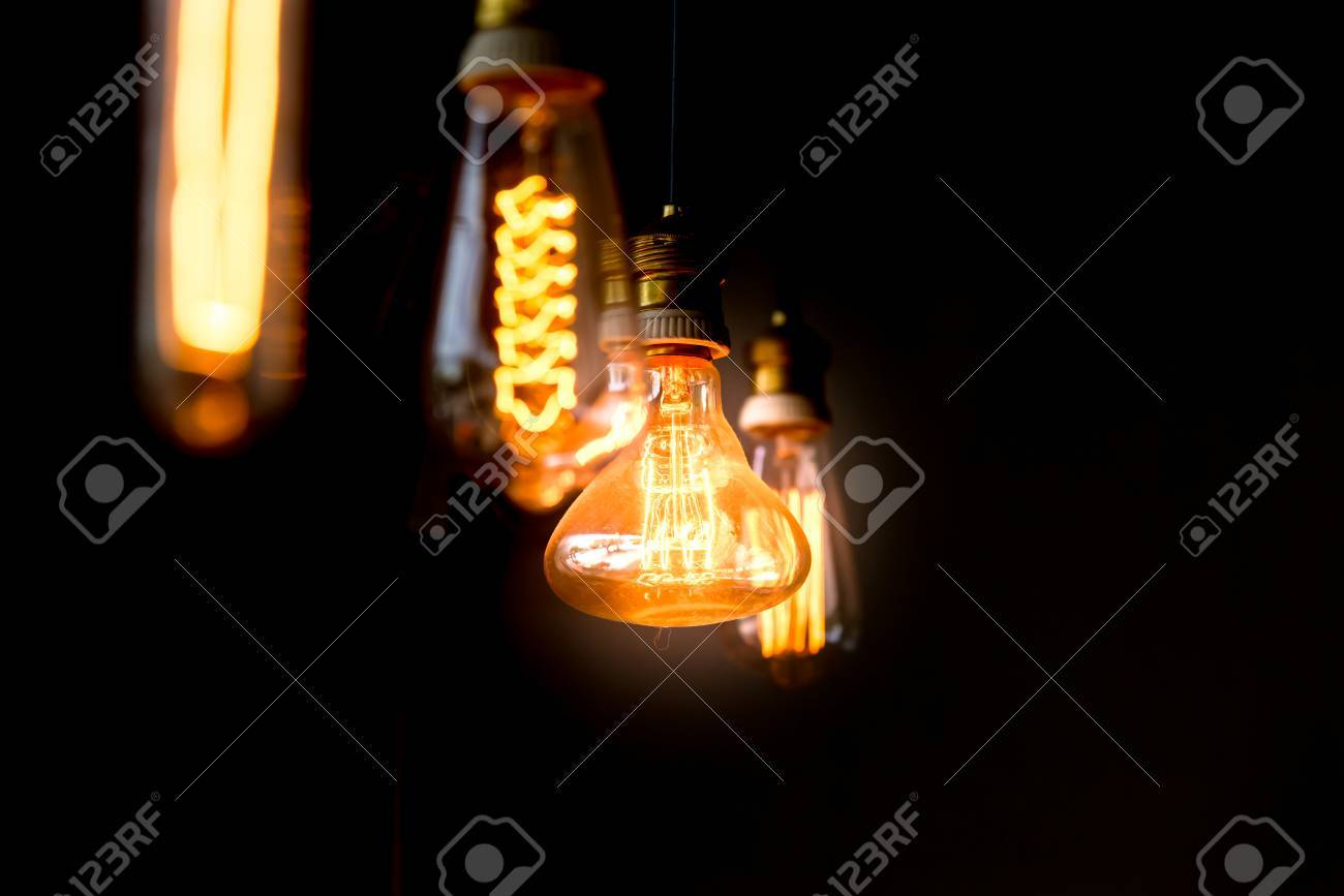 Dark Room With Light Bulb - Hanged orange decoration light bulbs focus on pear shape like one in the dark room one