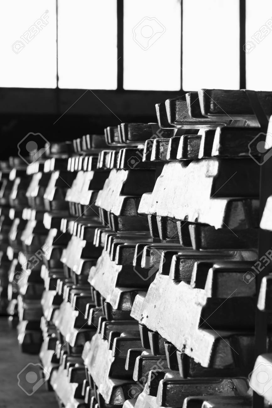 aluminum ingots stacked in the warehouse waiting for meltting - 116921185