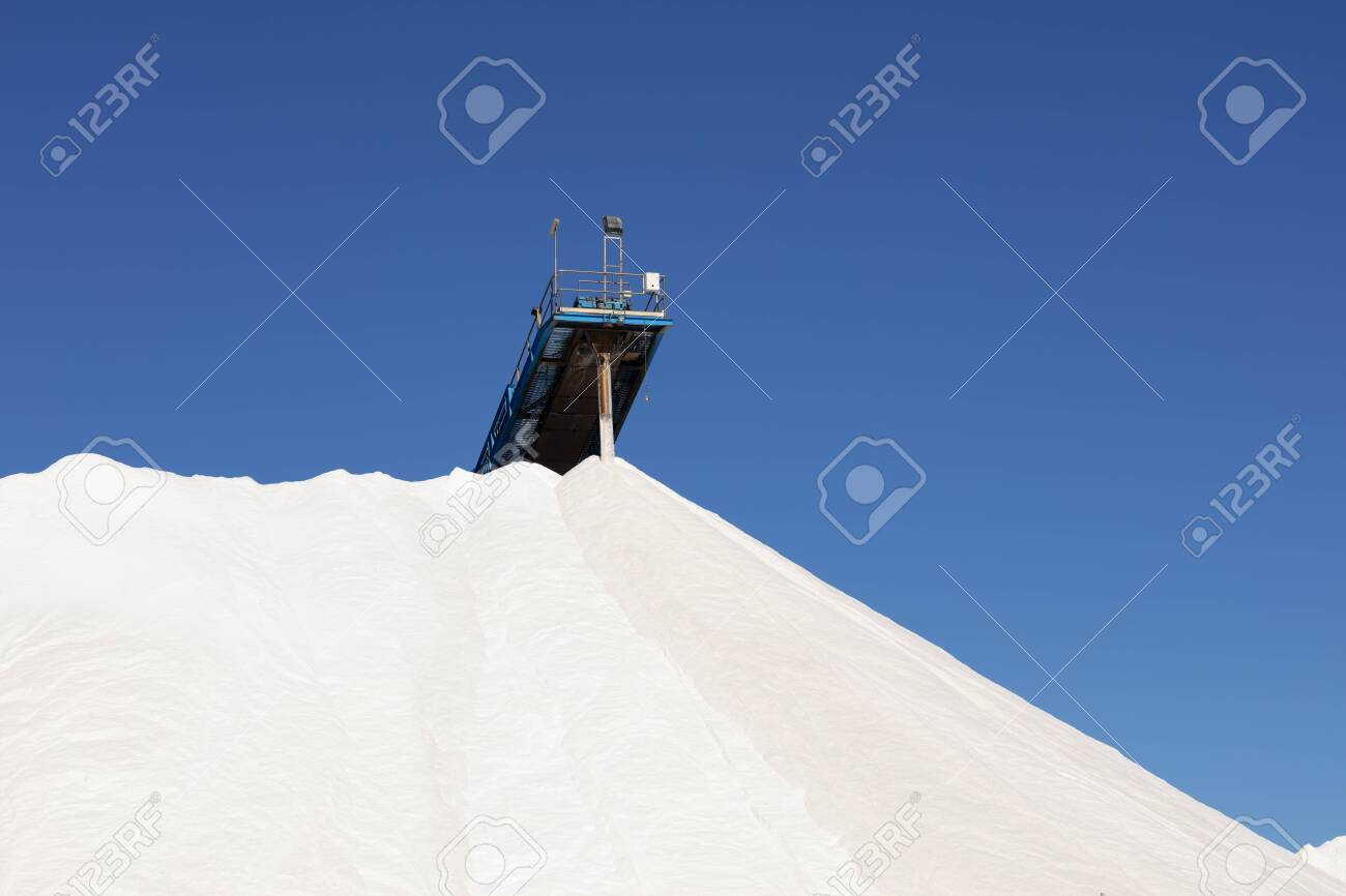 mountain of white salt on blue sky, salt extraction process and piled up - 116921188