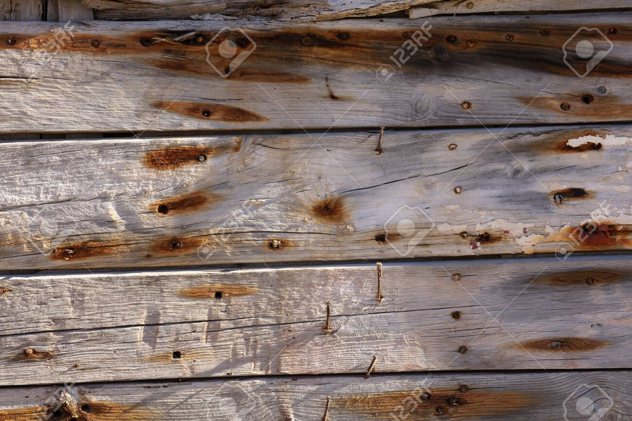 very old wooden planks, with rusty nails and orange markings. Photo with high resolution and texture - 116921196