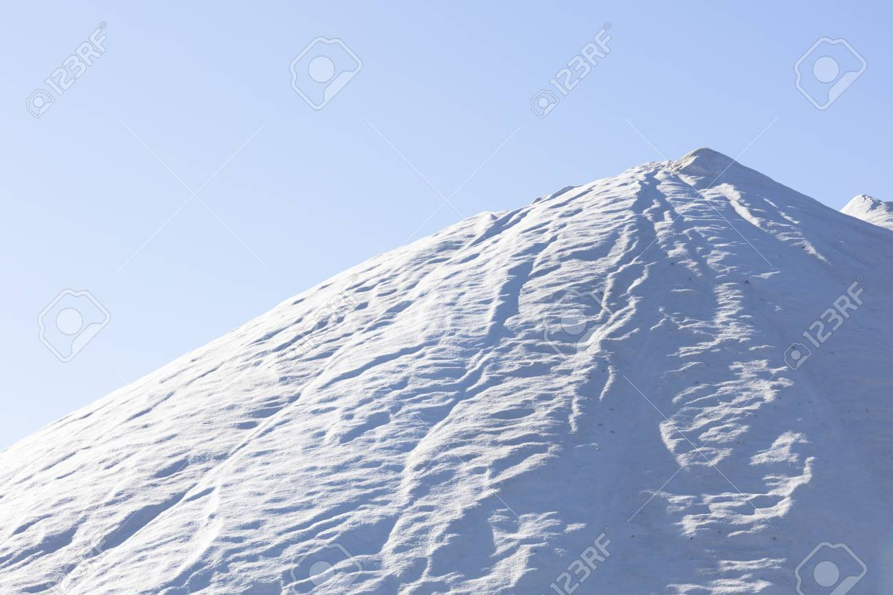 white salt mountain on blue background, high resolution image and size - 116921198
