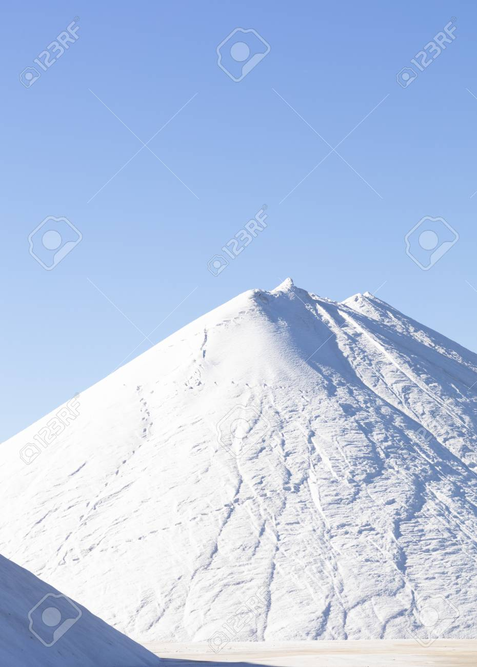 white salt mountain on blue background, high resolution image and size - 116921202