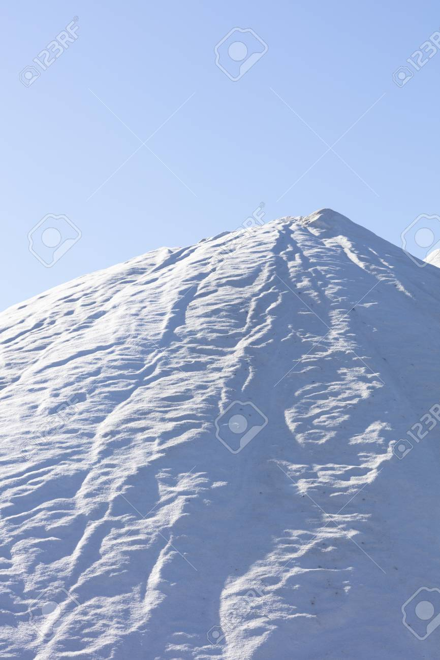 white salt mountain on blue background, high resolution image and size - 116921203