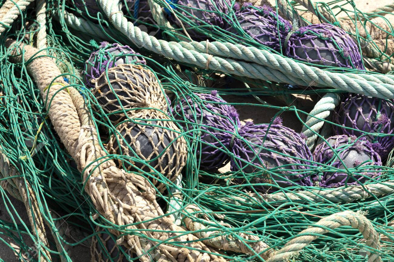 fishing nets in the port to be revised, there are blue, purple and green - 123523611