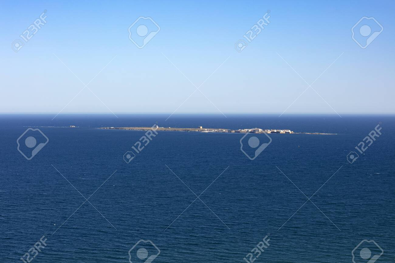 panoramic view of Tabarca island from the Santa Pola lighthouse in Alicante, Spain, on an intense blue mediterranean sea and clear sky - 123523655