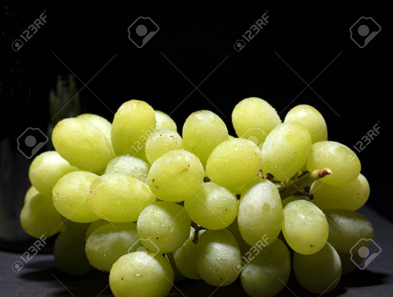 bunch of white grapes with water drops on black background - 123523726