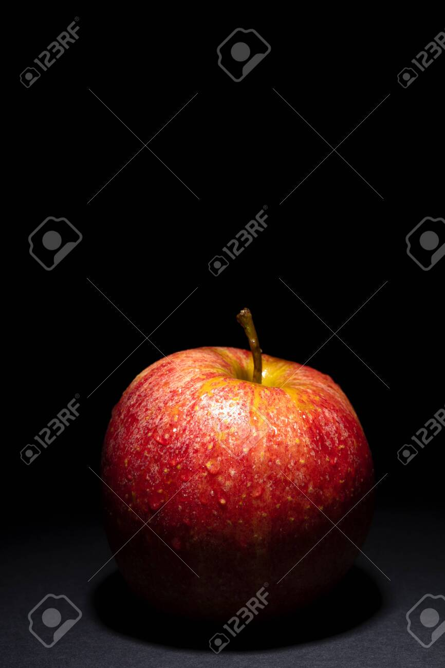 red apple with drops of water on black background, image conveys freshness, free space above for text - 123523739